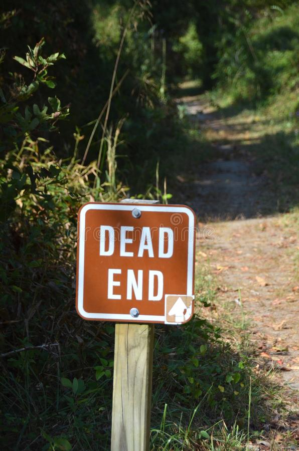 Dead End. A sign by the side of the path warns of the dead end ahead royalty free stock photography