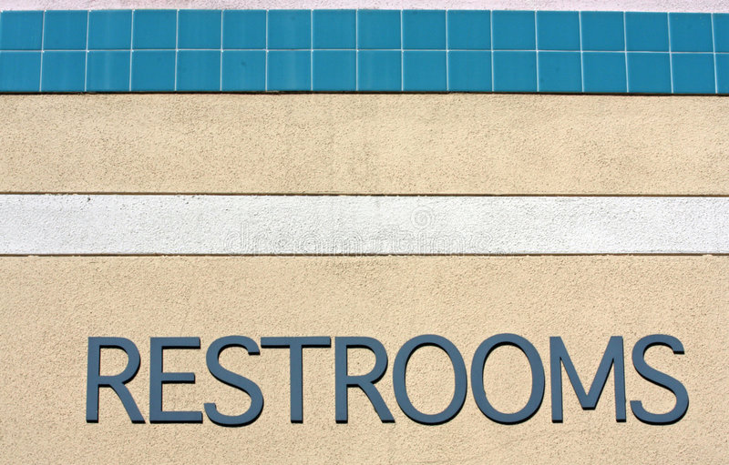 Sign stating RESTROOMS