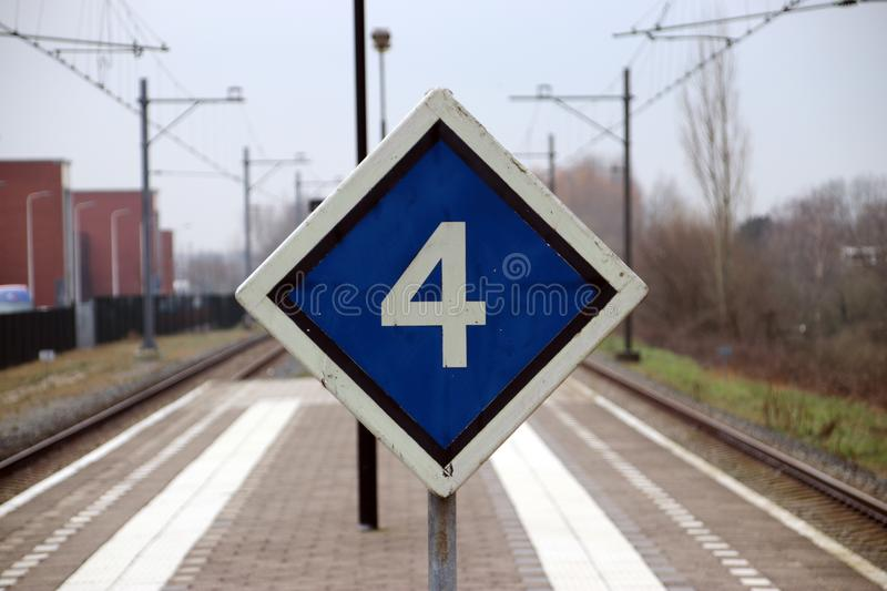 sign with stop advice for train with 4 cars in the middle of 2 p stock photography