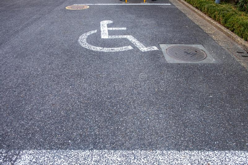 Sign on the street indicates the parking lot for the disabled royalty free stock photos