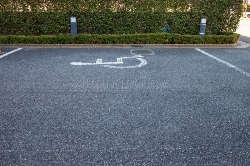 Sign on the street indicates the parking lot for the disabled. The sign on the street indicates the parking lot for the disabled royalty free stock image