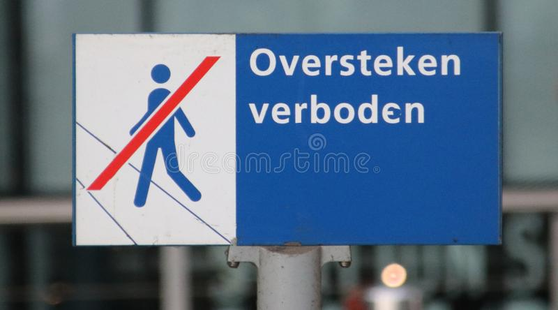 Sign at the streetcar station at Den Haag Centraal indication that crossing the tram rails is not allowed. stock photos