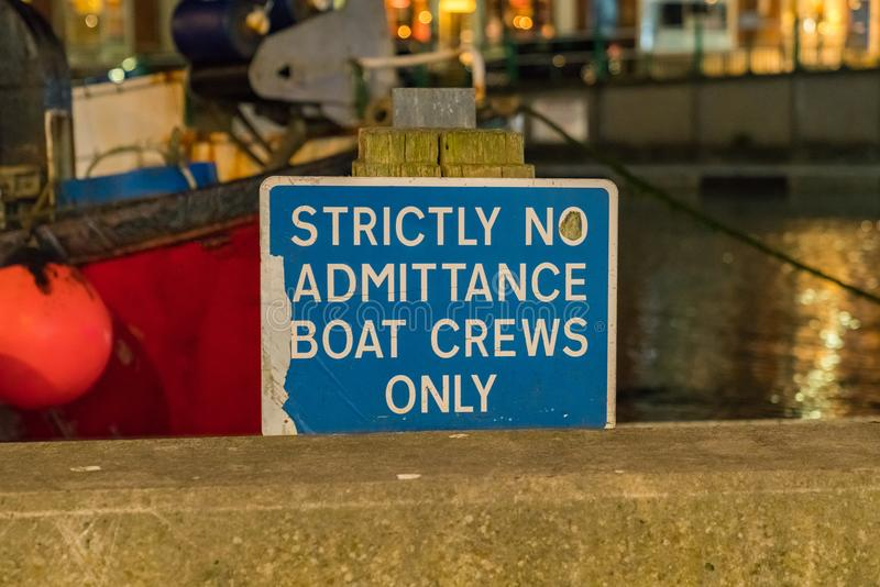 Sign: Strictly no admittance boat crews only stock photo