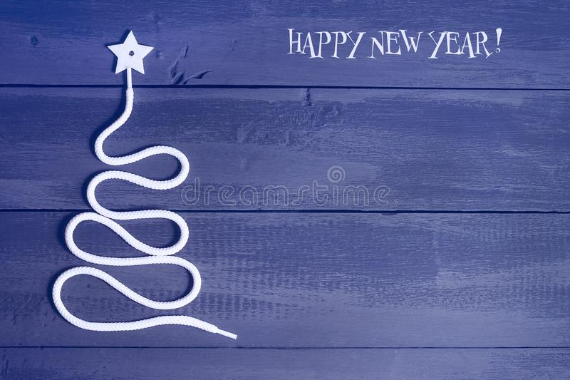 Sign symbol Christmas tree on a wooden background. A copy of space. The idea of a merry new year. Christmas. stock photos