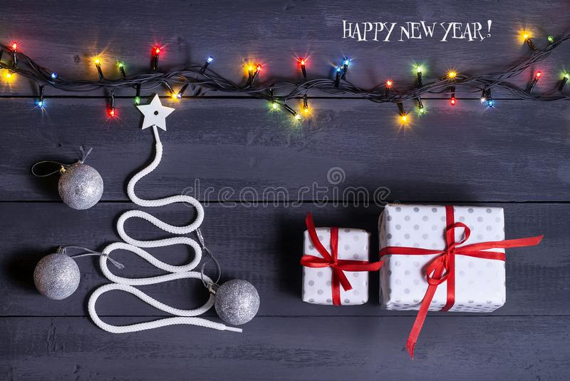 Sign symbol Christmas tree on a wooden background. A copy of space. The idea of a merry new year. Christmas. royalty free stock images