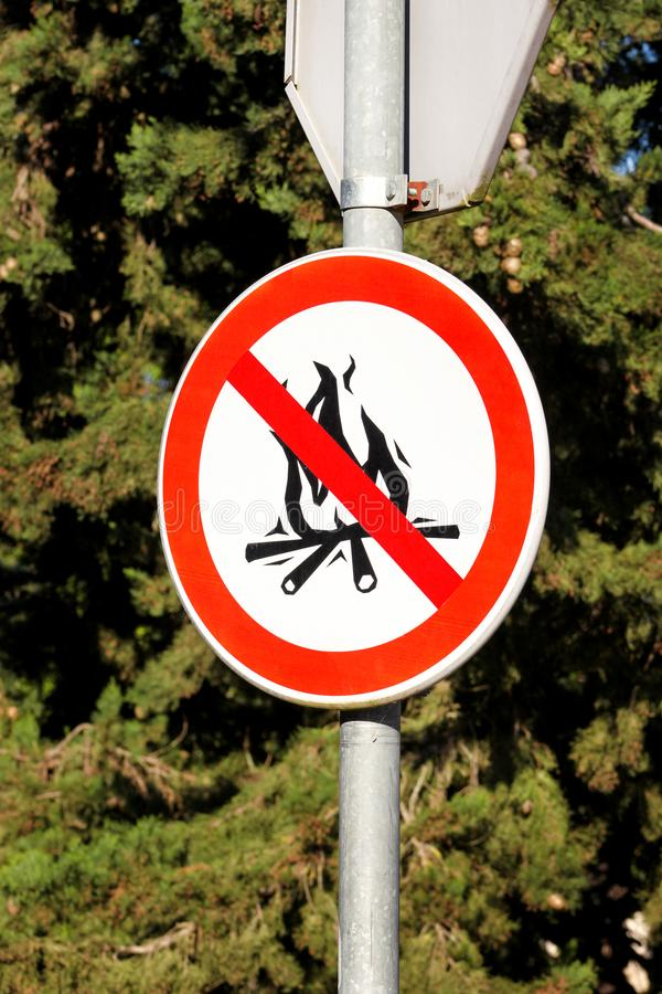 Sign or symbol no campfire, do not light a fire. No Campfires sign, in nature by sea. No open flame sign. royalty free stock images