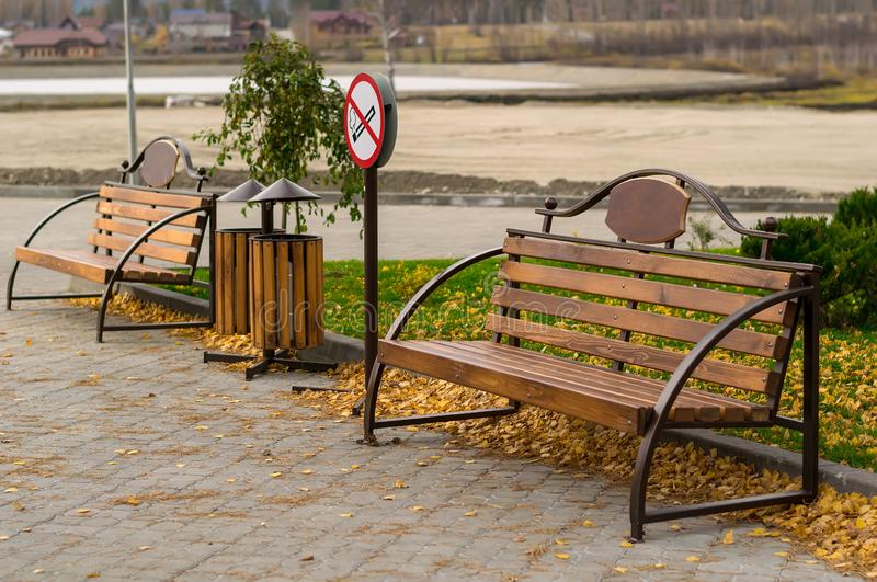Symbol, Smoking area, with benches in the Park under construction for tourism and recreation stock images