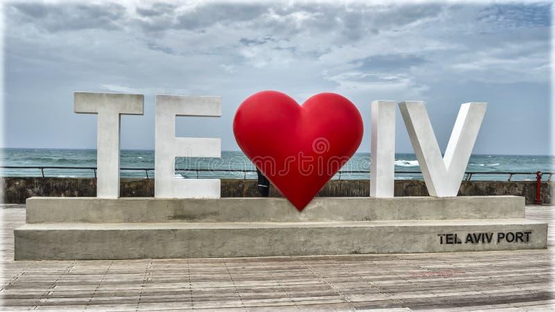 Tel-Aviv Port at stormy day. Sign `TeLOVEviv` Tel-Aviv at the embankment of the new port at stormy day stock images