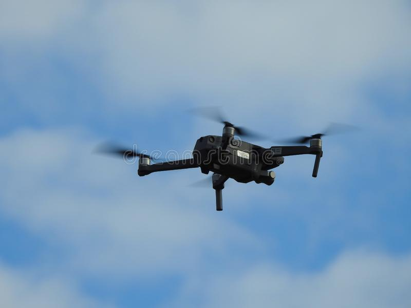 A sign of the times!. Drones are more and more common in our society.  This drone was hovering over a concert to watch the crowd.  Big Brother is always watching royalty free stock photos