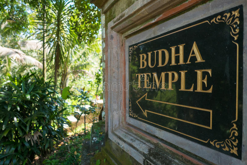 Sign to Buddha temple in Ubud, Bali Island. Indonesia royalty free stock photography