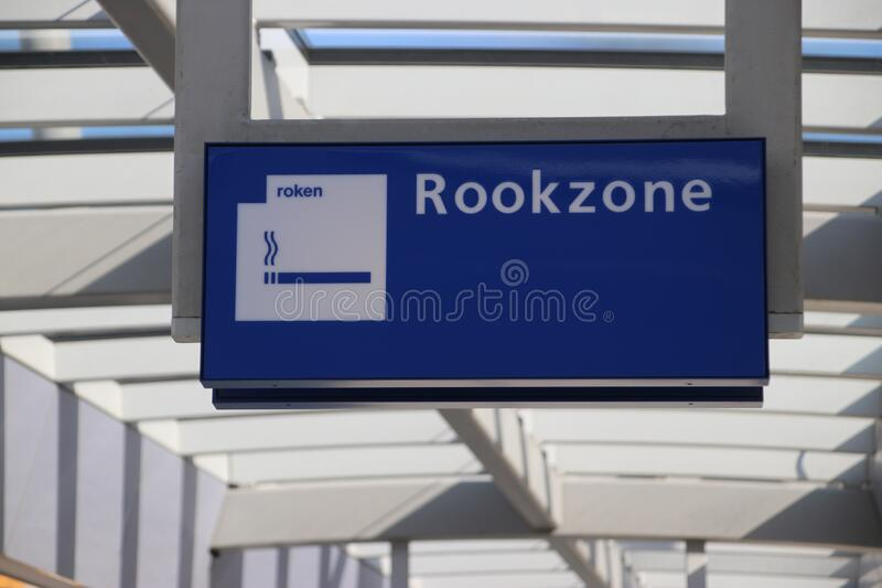 Sign to designated area where smoking is allowed on railroad platform of utrecht stock image