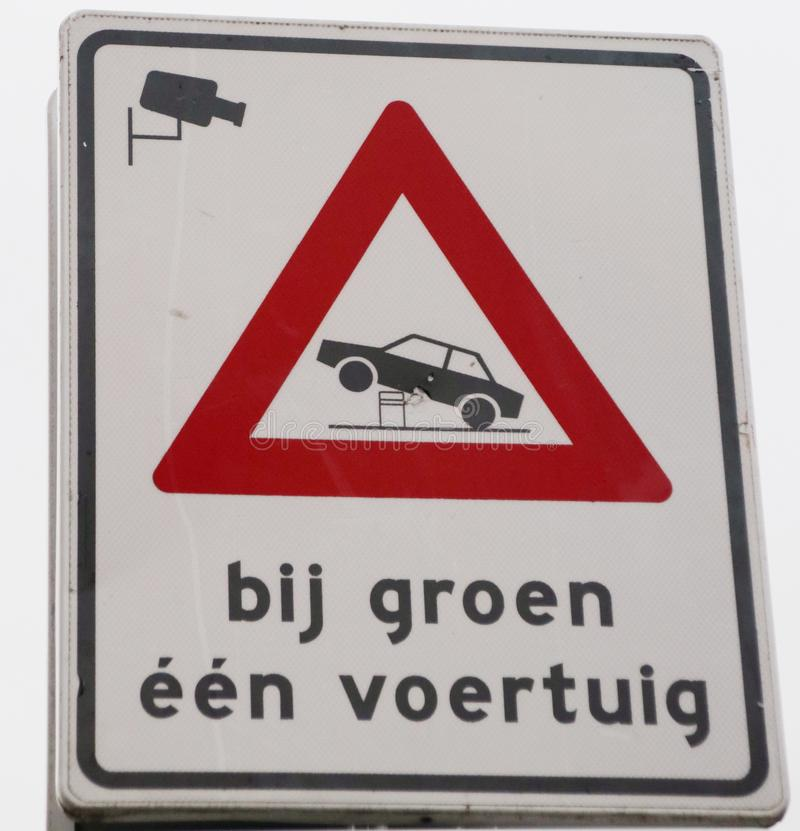 Sign to warn for automatic pole in the streets of the hague and that with green light only one car is allowed bij groeneen voertu royalty free stock image