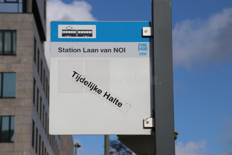 Sign for tram and bus stop at station Den Haag Laan van NOI as temporary stop. royalty free stock photo
