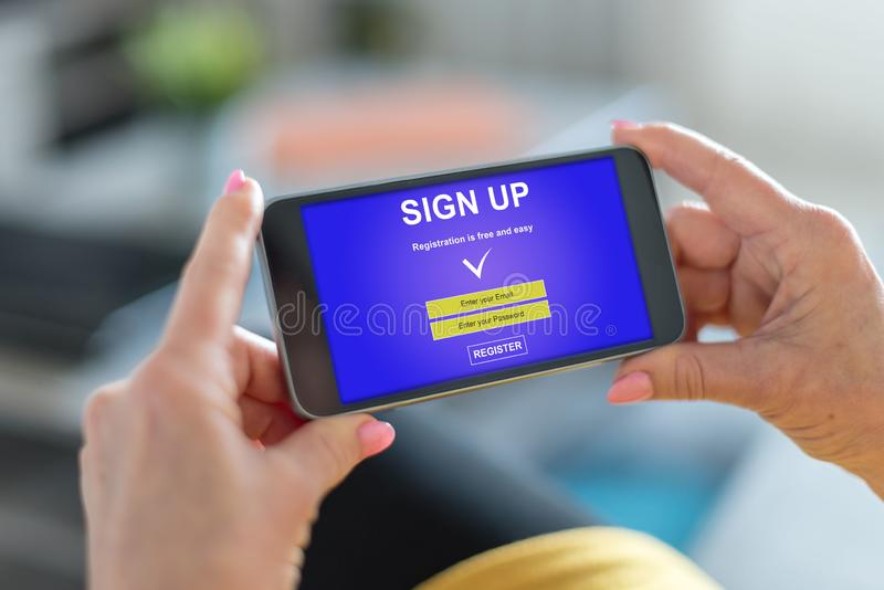 Sign up concept on a smartphone. Smartphone screen displaying a sign up concept stock photos
