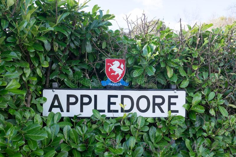 Sign for the village of Appledore, Kent, United Kingdom. In a hedge stock photo