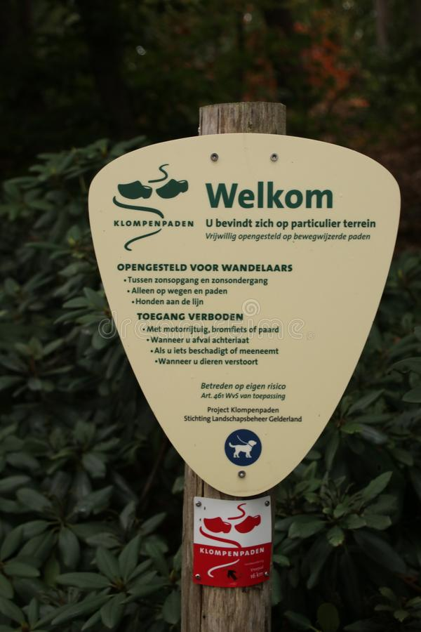 Sign for walking direction and behaviour rules of a clog path on the Veluwe in Gelderland, The Netherlands. royalty free stock photo