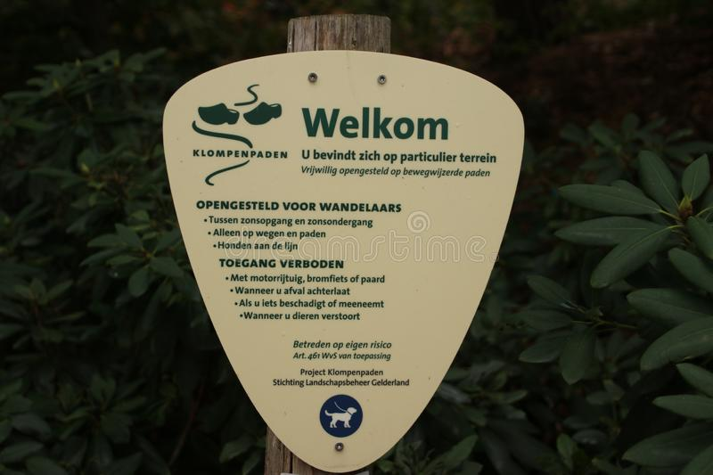 Sign for walking direction and behaviour rules of a clog path on the Veluwe in Gelderland, The Netherlands. royalty free stock photos