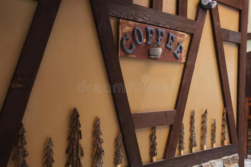 A sign on the wall `saying coffee`. royalty free stock photography