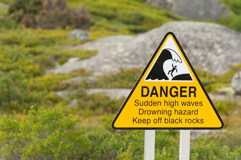 High waves warning. Sign warning about danger of sudden high waves on the Nova Scotia coastline, Canada stock photos