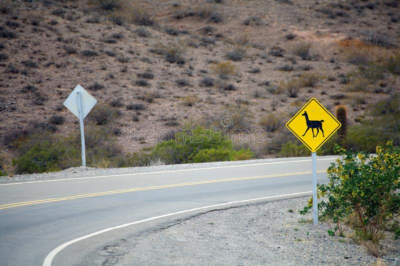 Sign warning of llama crossing along the National Route 40 also known as Ruta 40, Argentina stock photography