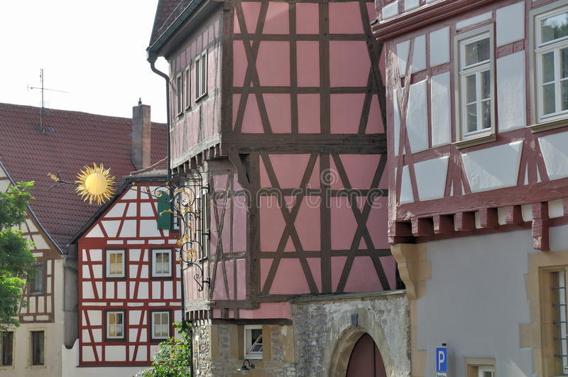 Sign and wattle, bad wimpfen. Sun sign and sunny facades of old wattle houses in city center stock photo