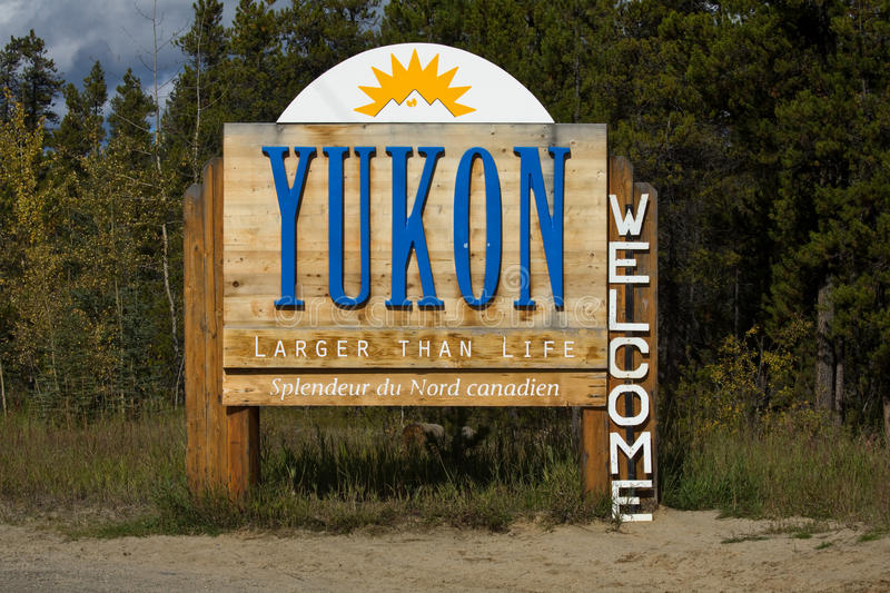Sign welcoming visitors to the Yukon stock photography
