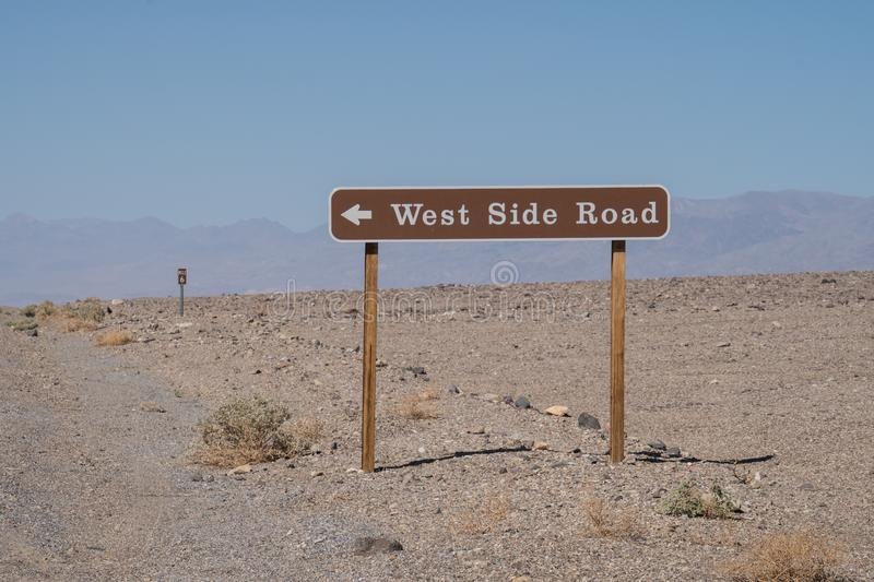 Sign for West Side Road, a remote backcountry desert, dirt road in Death Valley National Park in California royalty free stock photo