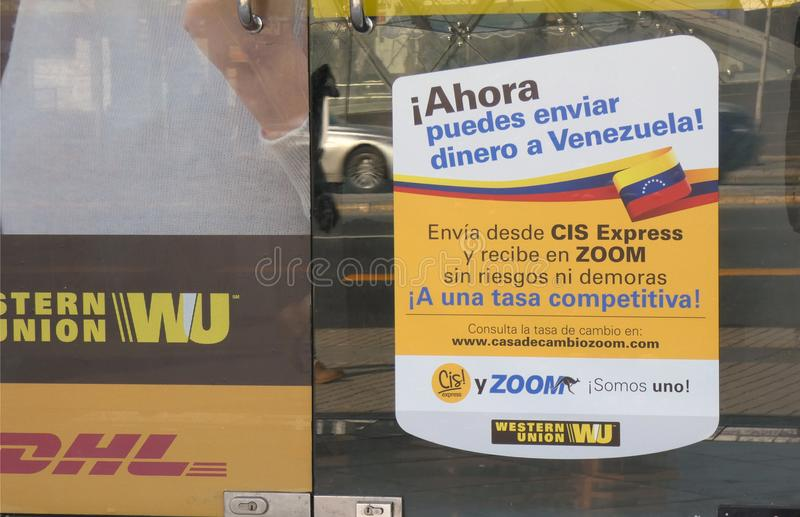 Venezuelan Crisis. A sign at a Western Union, in Santiago, Chile, aimed at Venezuelan immigrants. It reads: Now you can send money to Venezuela stock images