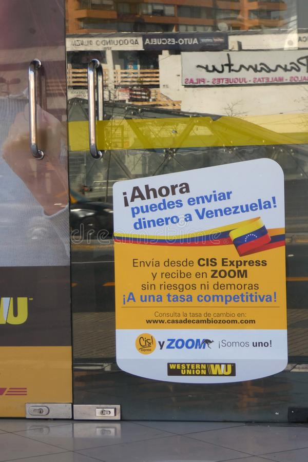 Venezuelan Crisis. A sign at a Western Union, in Santiago, Chile, aimed at Venezuelan immigrants. It reads: Now you can send money to Venezuela royalty free stock image