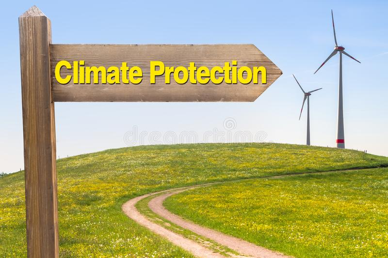 Climate Protection Concept. Sign with the Words Climate Protection and Wind Turbines in the Background royalty free stock images