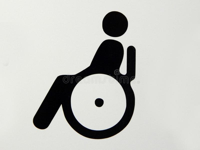 Signage d'handicap avec la personne sur l'image de fauteuil roulant photos libres de droits