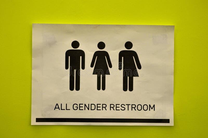 Signage do toalete de todos os tipos ao lado de um banheiro fotos de stock