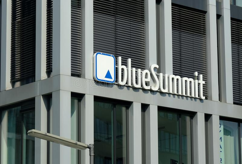 Signage of the German company Blue Summit Media. Munich, Germany - August 17, 2017: Blue Summit company logo. Blue Summit Media GmbH is an agency for stock images