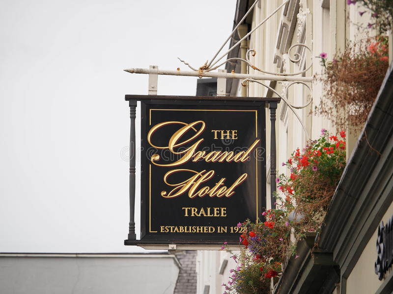 Signage For Hotel In Tralee Ireland. Signage for hotel with red geraniums in Tralee Ireland royalty free stock images