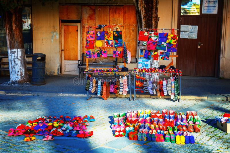Wool slippers in Sighnaghi town, Kakheti region, Georgia. Signagi, Georgia - 20 April, 2017: wool slippers and socks Georgian felted bright souvenir in Sighnaghi stock images