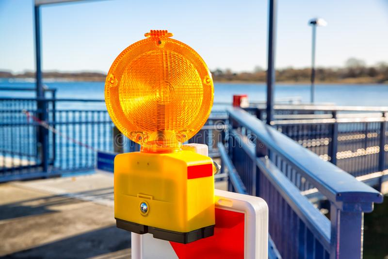Signal alarm flashlight. On guardrail of sea pier royalty free stock image