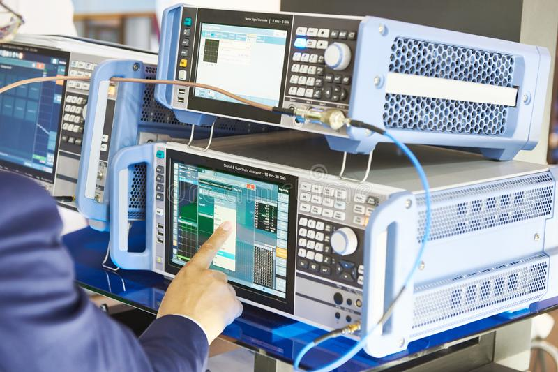 Signal analizer and generator. Man operator hand. Electronic devices signal analizer and generator. Man operator hand stock photos