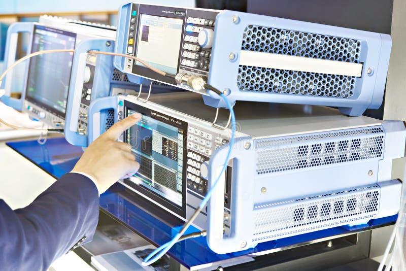 Signal analizer and generator. Man operator hand. Electronic devices signal analizer and generator. Man operator hand stock photography