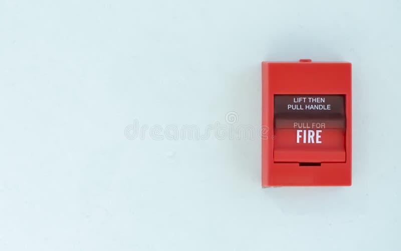 Signal d'incendie sur le mur images stock
