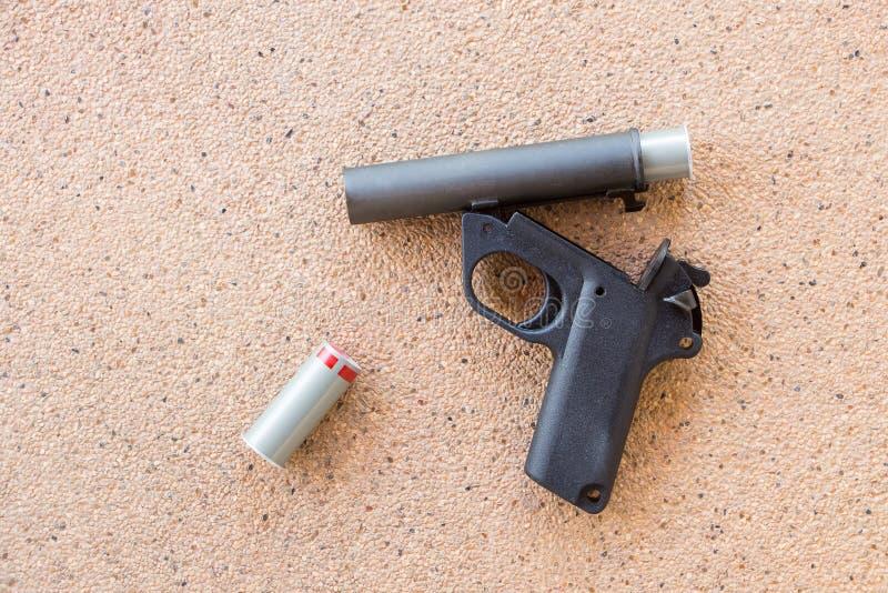 Signal Flare Pistol gun On Terrazzo Floor. Background royalty free stock photo