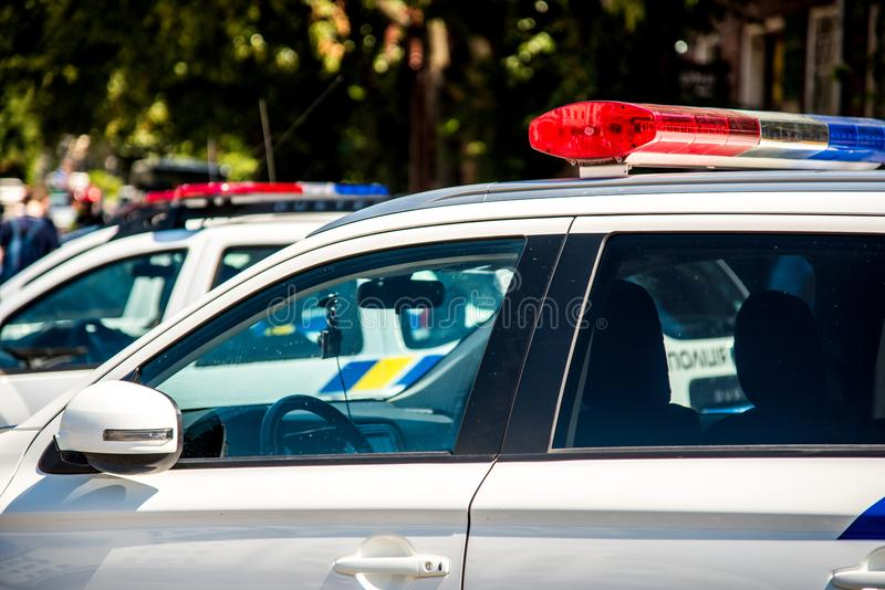Signal lamps on police cars against a fragment of a city street. Security, help, law - concept stock image