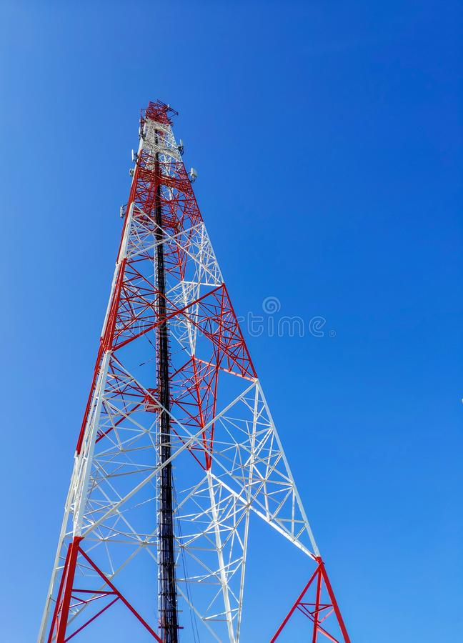 Signal tower, Telephone pole, very tall and large  Sky background stock image