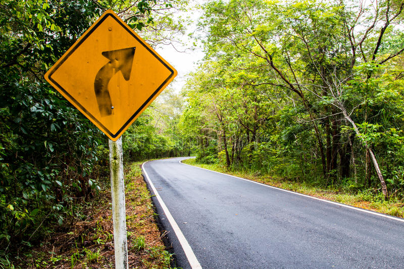 Signal turn right on country road, Traffic Signs. Curve signs,Traffic that is ahead of the curve, traffic signs on the road in thailand stock photos