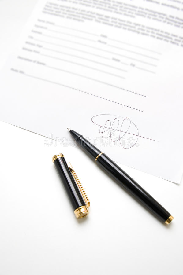 Signature. Black pen on a contract with signature stock photos