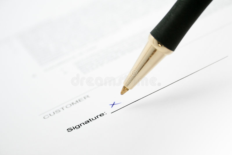 Signature d'un contrat photographie stock libre de droits
