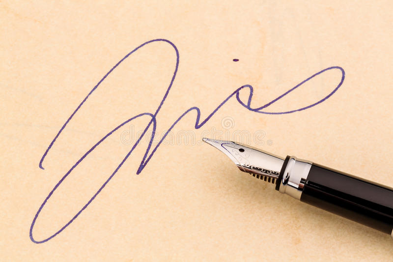 Signature and fountain pen royalty free stock images