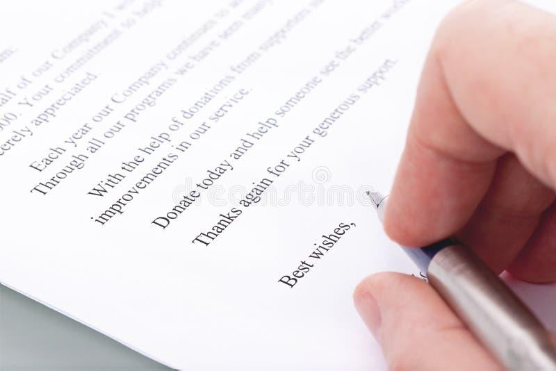 Signature sur une lettre des merci de la donation images libres de droits
