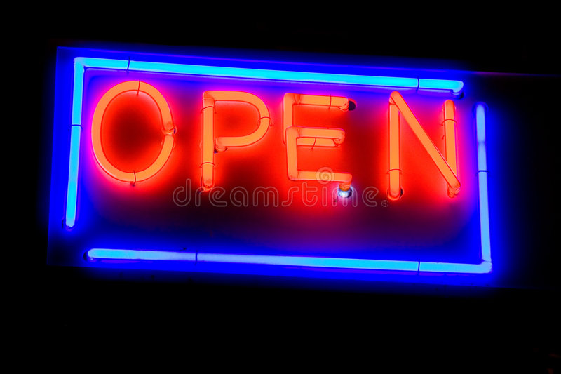 Signboard. In neon light at night royalty free stock photography