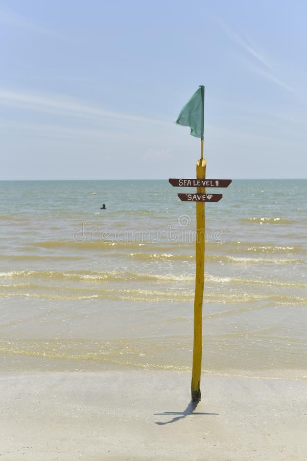 `sea level` signboard by the beach. Signboard by the beach.written `sea level` and `save` for tourist stock images