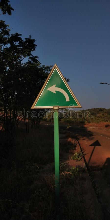 Signboard. Directions triangle left evening royalty free stock photography
